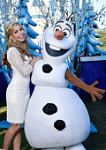 In this handout photo provided by Disney Parks Miss America 2015 Kira Kazantsev with Olaf attends the taping of the Disney Parks 'Frozen Christmas...