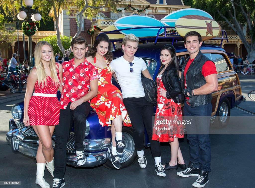 In this handout photo provided by Disney Parks, Mollee Gray, Garrett Clayton, Maia Mitchell, Ross Lynch, Grace Phipps and John DeLuca of the hit Disney Channel Original Movie 'Teen Beach Movie' perform a medley of songs during a taping for the 'Disney Parks Christmas Day Parade' television special at Disneyland on November 10, 2013 in Anaheim, California. 'Disney Parks Christmas Day Parade' airs December 25 on ABC.