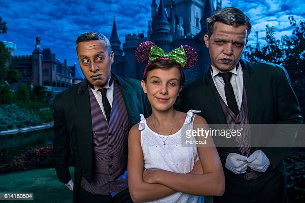 In this handout photo provided by Disney Parks Netflix's 'Stranger Things' star Millie Bobby Brown known as 'Eleven' a girl with super powers against...