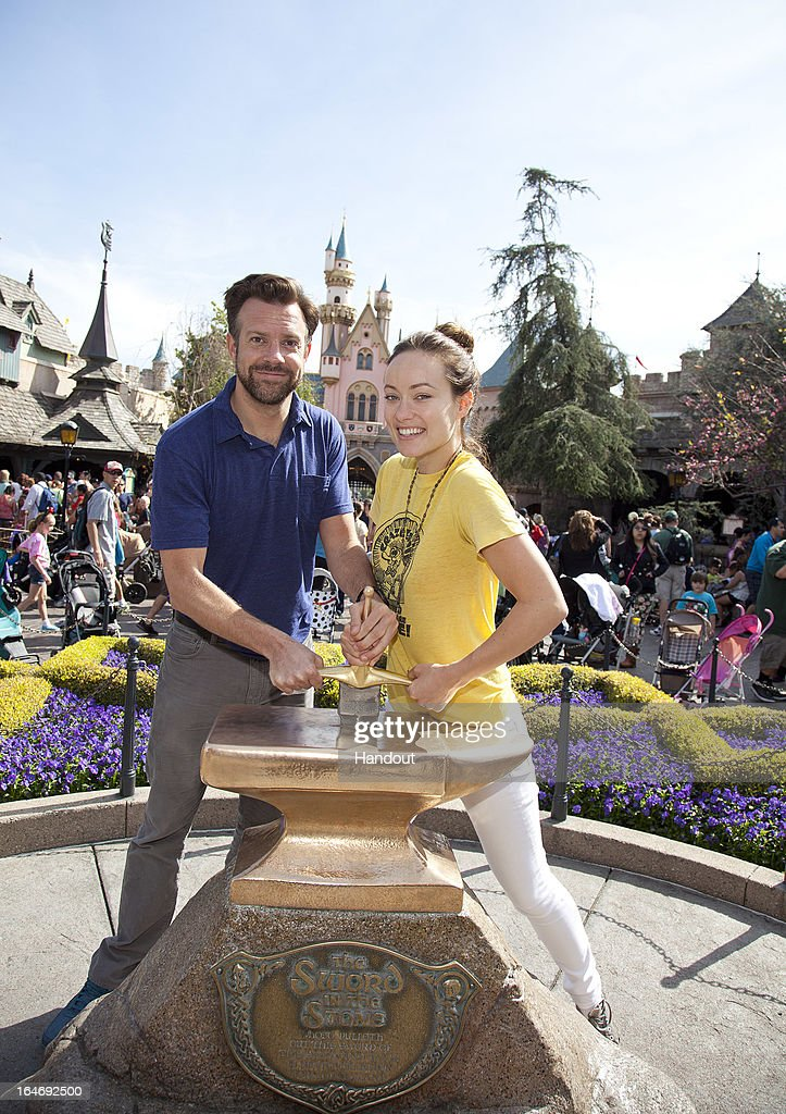 In this handout photo provided by Disney Parks, Newly-engaged couple Jason Sudeikis and Olivia Wilde try their luck at removing the 'Sword in the Stone' at Disneyland park in Anaheim on March 26, 2013 in Anaheim, California.