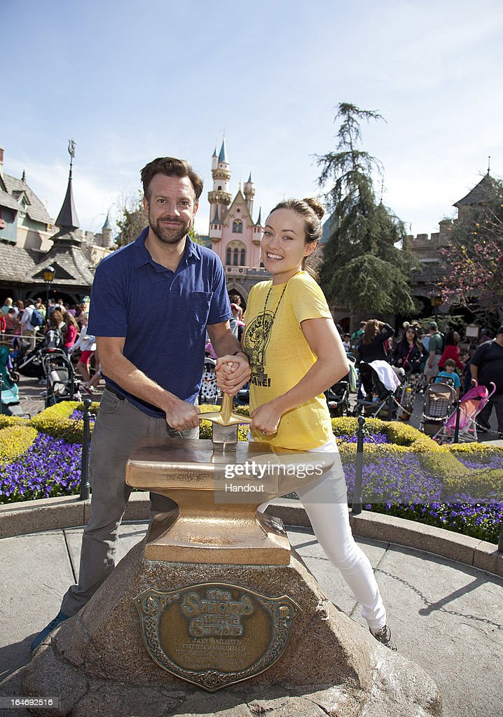 In this handout photo provided by Disney Parks, Newly-engaged couple <a gi-track='captionPersonalityLinkClicked' href=/galleries/search?phrase=Jason+Sudeikis&family=editorial&specificpeople=4232997 ng-click='$event.stopPropagation()'>Jason Sudeikis</a> and <a gi-track='captionPersonalityLinkClicked' href=/galleries/search?phrase=Olivia+Wilde&family=editorial&specificpeople=235399 ng-click='$event.stopPropagation()'>Olivia Wilde</a> try their luck at removing the 'Sword in the Stone' at Disneyland park in Anaheim on March 26, 2013 in Anaheim, California.