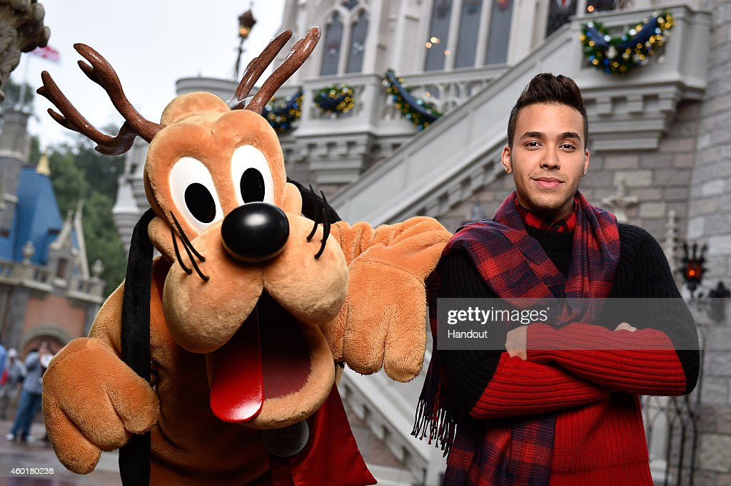 In this handout photo provided by Disney Parks, <a gi-track='captionPersonalityLinkClicked' href=/galleries/search?phrase=Prince+Royce&family=editorial&specificpeople=6918529 ng-click='$event.stopPropagation()'>Prince Royce</a> and Reindeer Pluto attend the taping of the Disney Parks 'Frozen Christmas Celebration' TV Special in the Magic Kingdom Park at the Walt Disney World Resort on December 8, 2014 in Lake Buena Vista, Florida. The special will air on December 25, 2014.