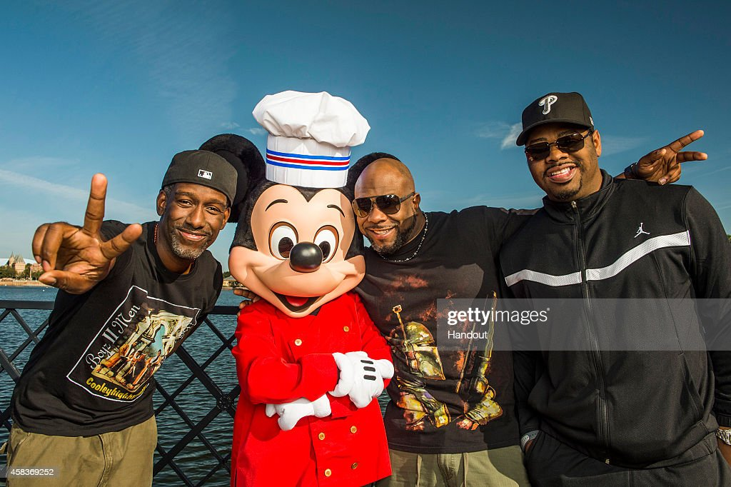 In this handout photo provided by Disney Parks Shawn Stockman Wayna Morris and Nathan Morris of Boyz II Men pose with Mickey Mouse during the 19th...