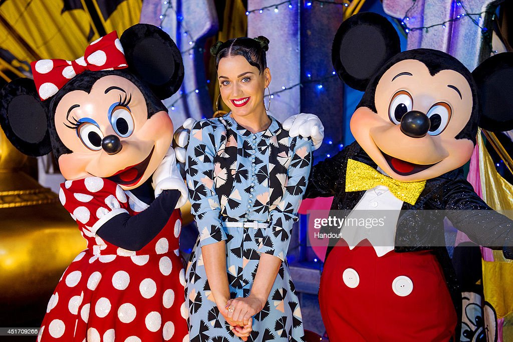 In this handout photo provided by Disney Parks, singer <a gi-track='captionPersonalityLinkClicked' href=/galleries/search?phrase=Katy+Perry&family=editorial&specificpeople=599558 ng-click='$event.stopPropagation()'>Katy Perry</a> poses with Minnie Mouse and Mickey Mouse at Disney's Hollywood Studios at Walt Disney World Resort on July 4, 2014 in Lake Buena Vista, Florida. <a gi-track='captionPersonalityLinkClicked' href=/galleries/search?phrase=Katy+Perry&family=editorial&specificpeople=599558 ng-click='$event.stopPropagation()'>Katy Perry</a>, who sang the hit song 'Firework,' visited Walt Disney World Resort on U.S. Independence Day during a break in her global 'Prismatic' concert tour.