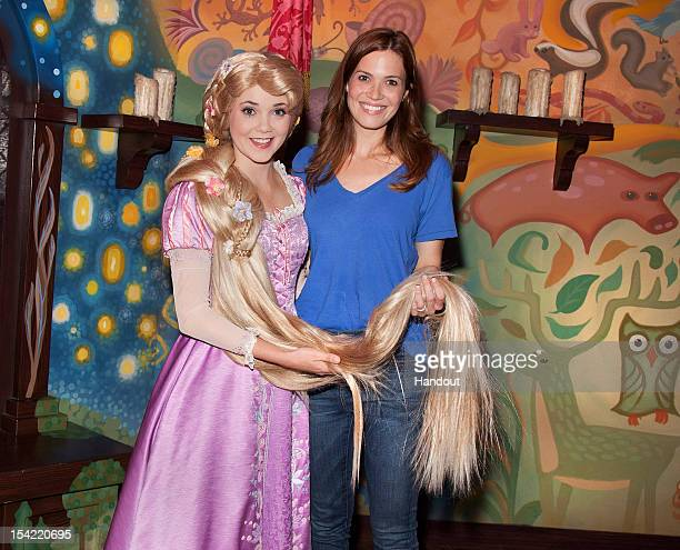 In this handout photo provided by Disney Parks singer/actress Mandy Moore poses with Rapunzel at Disneyland Park October 15 2012 in Anaheim...