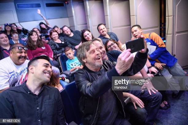 In this handout photo provided by Disney Parks 'Star Wars The Last Jedi' star Mark Hamill surprises guests on board the Star Tours attraction at...
