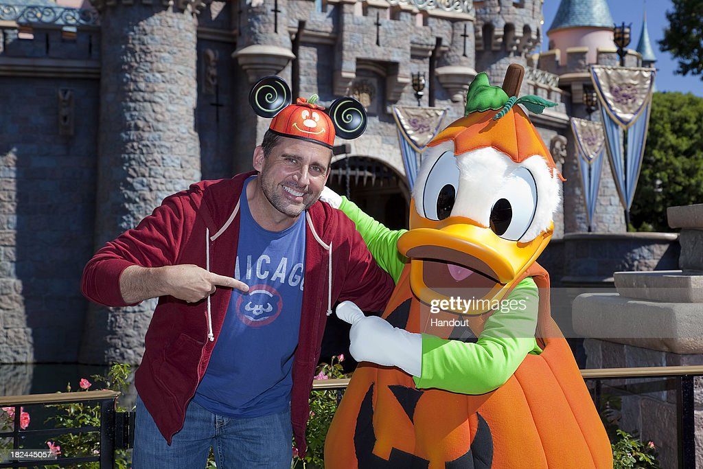 In this handout photo provided by Disney Parks, Steve Carell poses with Donald Duck while visiting Disneyland during 'Halloween Time' on September 29, 2013 in Anaheim, California.