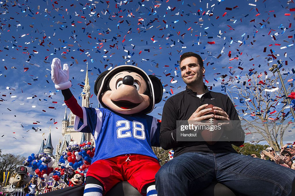 In this handout photo provided by Disney Parks, Super Bowl XLVII MVP Joe Flacco rides with Mickey Mouse in a parade through the Magic Kingdom at Walt Disney World Resort February 4, 2013 in Lake Buena Vista, Florida. Flacco led his Baltimore Ravens to a 34-31 win over the San Francisco 49ers last night in New Orleans. After the game, Flacco starred in a commercial where he proclaimed 'I'm Going to Disney World!'
