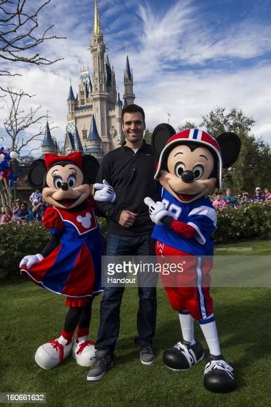 In this handout photo provided by Disney Parks Super Bowl XLVII MVP Joe Flacco poses with Mickey and Minnie Mouse at the Magic Kingdom at Walt Disney...