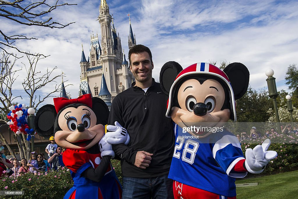 In this handout photo provided by Disney Parks, Super Bowl XLVII MVP Joe Flacco poses with Mickey and Minnie Mouse at the Magic Kingdom at Walt Disney World Resort February 4, 2013 in Lake Buena Vista, Florida. Flacco led his Baltimore Ravens to a 34-31 win over the San Francisco 49ers last night in New Orleans. After the game, Flacco starred in a commercial where he proclaimed 'I'm Going to Disney World!'