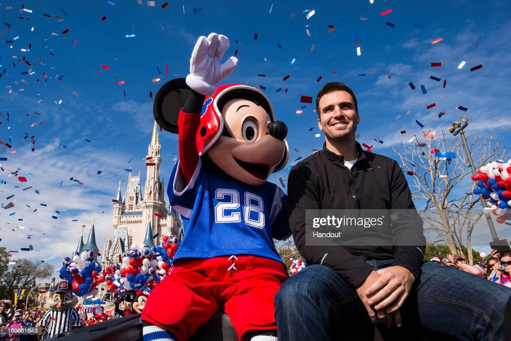 In this handout photo provided by Disney Parks, Super Bowl XLVII MVP <a gi-track='captionPersonalityLinkClicked' href=/galleries/search?phrase=Joe+Flacco&family=editorial&specificpeople=4645672 ng-click='$event.stopPropagation()'>Joe Flacco</a> rides with Mickey Mouse in a parade through the Magic Kingdom at Walt Disney World Resort February 4, 2013 in Lake Buena Vista, Florida. Flacco led his Baltimore Ravens to a 34-31 win over the San Francisco 49ers last night in New Orleans. After the game, Flacco starred in a commercial where he proclaimed 'I'm Going to Disney World!'