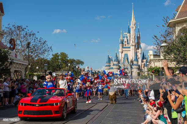 In this handout photo provided by Disney Parks Super Bowl XLVII MVP Malcolm Smith of the Seattle Seahawks participates in his parade at the Magic...