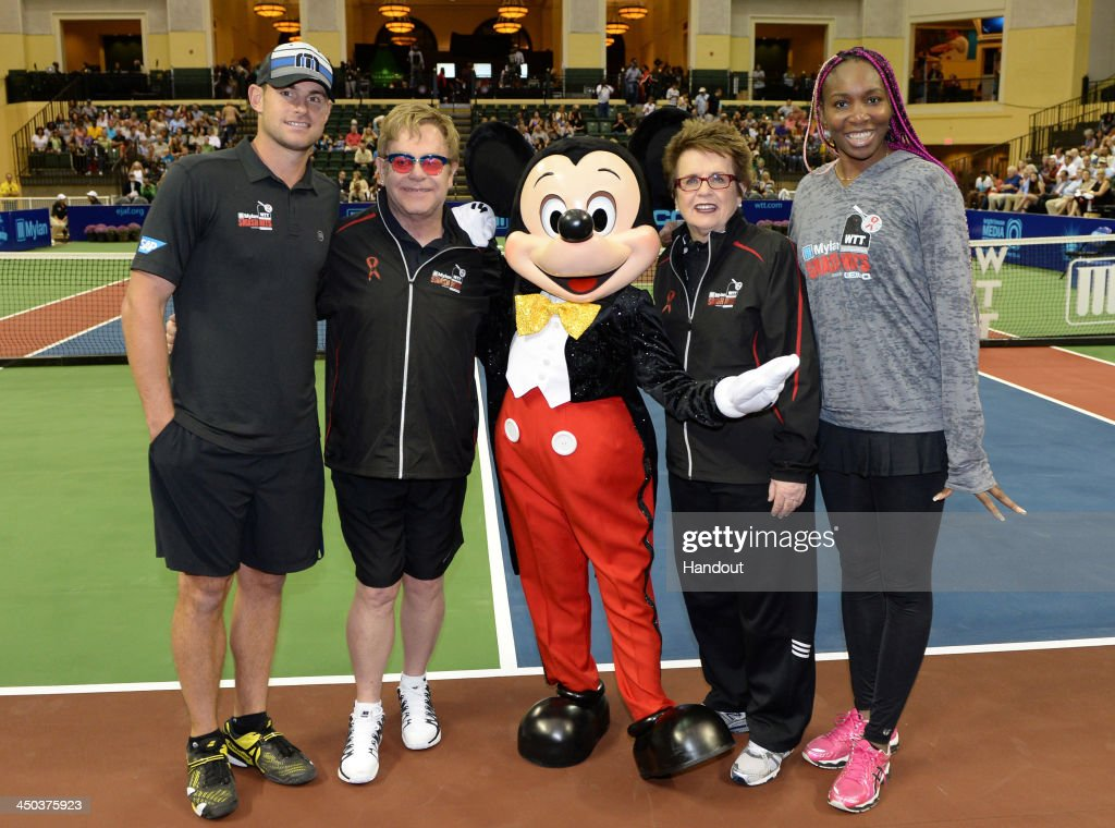 In this handout photo provided by Disney Parks, (L-R) Tennis star Andy Roddick, entertainer Sir Elton John, tennis legend Billie Jean King and women's tennis champ Venus Williams pose with Mickey Mouse before an exhibition tennis match at ESPN Wide World of Sports Complex at Walt Disney World Resort November 17, 2013 in Lake Buena Vista, Florida. John and King served as co-hosts of the '2013 Mylan WTT Smash Hits' exhibition at the Disney sports complex. Proceeds from the event benefit AIDS charities, including the Elton John AIDS Foundation. Since 1993, John and King have raised more than $11.5 million for AIDS charities through the tennis exhibition tour.