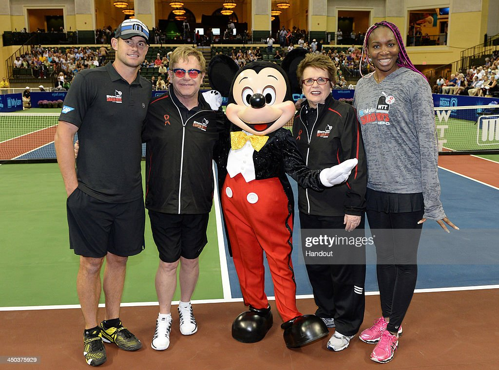 In this handout photo provided by Disney Parks, (L-R) Tennis star <a gi-track='captionPersonalityLinkClicked' href=/galleries/search?phrase=Andy+Roddick&family=editorial&specificpeople=167084 ng-click='$event.stopPropagation()'>Andy Roddick</a>, entertainer Sir <a gi-track='captionPersonalityLinkClicked' href=/galleries/search?phrase=Elton+John&family=editorial&specificpeople=171369 ng-click='$event.stopPropagation()'>Elton John</a>, tennis legend <a gi-track='captionPersonalityLinkClicked' href=/galleries/search?phrase=Billie+Jean+King&family=editorial&specificpeople=93147 ng-click='$event.stopPropagation()'>Billie Jean King</a> and women's tennis champ <a gi-track='captionPersonalityLinkClicked' href=/galleries/search?phrase=Venus+Williams&family=editorial&specificpeople=171981 ng-click='$event.stopPropagation()'>Venus Williams</a> pose with Mickey Mouse before an exhibition tennis match at ESPN Wide World of Sports Complex at Walt Disney World Resort November 17, 2013 in Lake Buena Vista, Florida. John and King served as co-hosts of the '2013 Mylan WTT Smash Hits' exhibition at the Disney sports complex. Proceeds from the event benefit AIDS charities, including the <a gi-track='captionPersonalityLinkClicked' href=/galleries/search?phrase=Elton+John&family=editorial&specificpeople=171369 ng-click='$event.stopPropagation()'>Elton John</a> AIDS Foundation. Since 1993, John and King have raised more than $11.5 million for AIDS charities through the tennis exhibition tour.