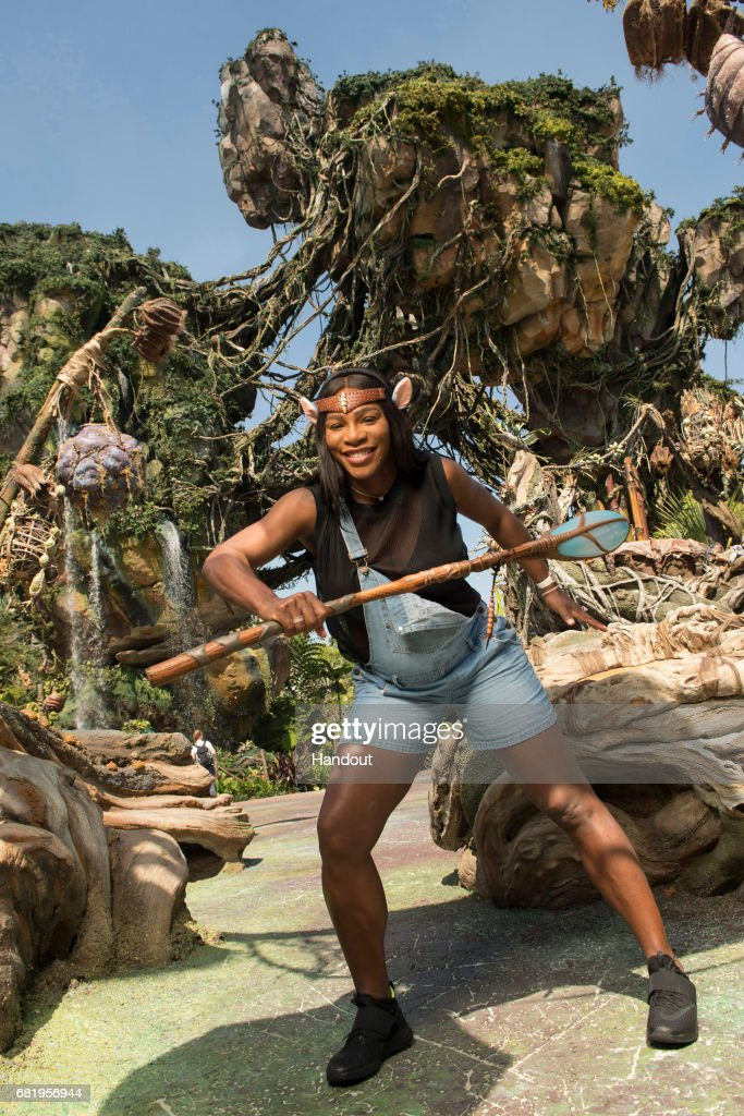 In this handout photo provided by Disney Parks, Tennis superstar Serena Williams channels her inner Na'vi during a sneak peek at Pandora - The World of Avatar at Disney's Animal Kingdom on May 9, 2017 in Lake Buena Vista, Florida. Williams, the world's No. 1-ranked player and reigning Australian Open champion, explored the newest themed land opening May 27 at Walt Disney World Resort, which immerses guests in a mystical world of massive floating mountains, bioluminescent rainforests and two breathtaking new attractions, Na'vi River Journey and Avatar Flight of Passage.
