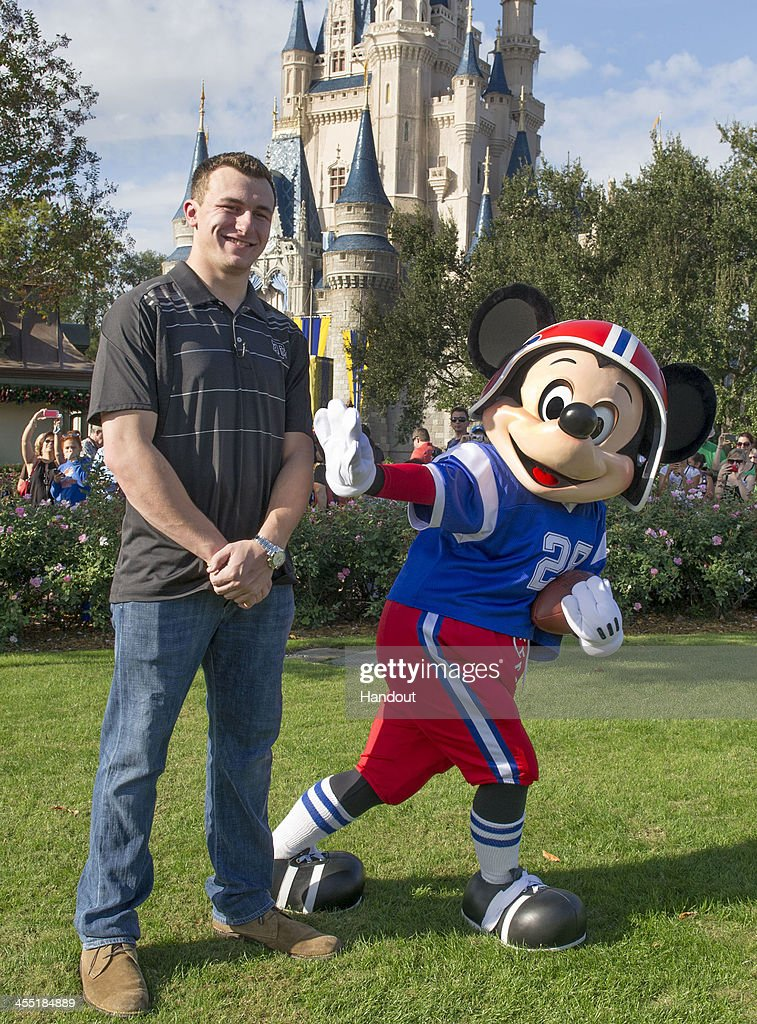 In this handout photo provided by Disney Parks Texas AM quarterback Johnny Manziel poses with Mickey Mouse at the Magic Kingdom park at Walt Disney...