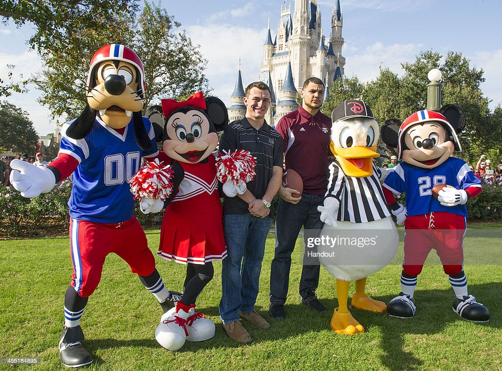 In this handout photo provided by Disney Parks Texas AM quarterback Johnny Manziel and Texas AM wide receiver Mike Evans pose with Disney characters...