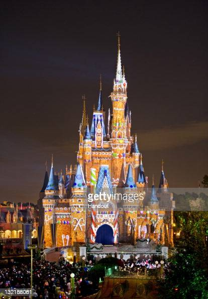 In this handout photo provided by Disney Parks the 189foottall Cinderella Castle appears to be a giant gingerbread house during a new holiday version...