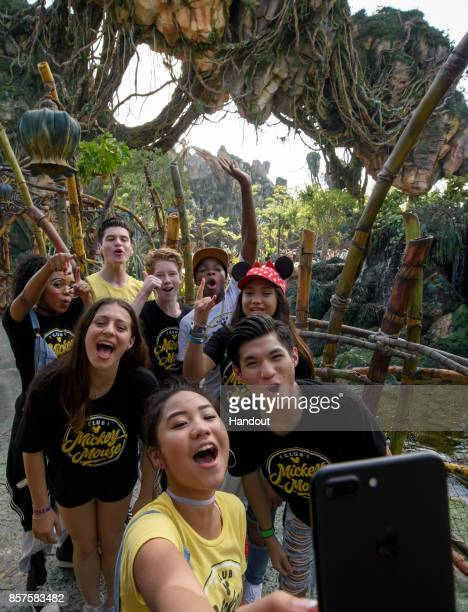 In this handout photo provided by Disney Parks the cast of Disney's reimagined 'Club Mickey Mouse' explores Pandora The World of Avatar at Disneys...