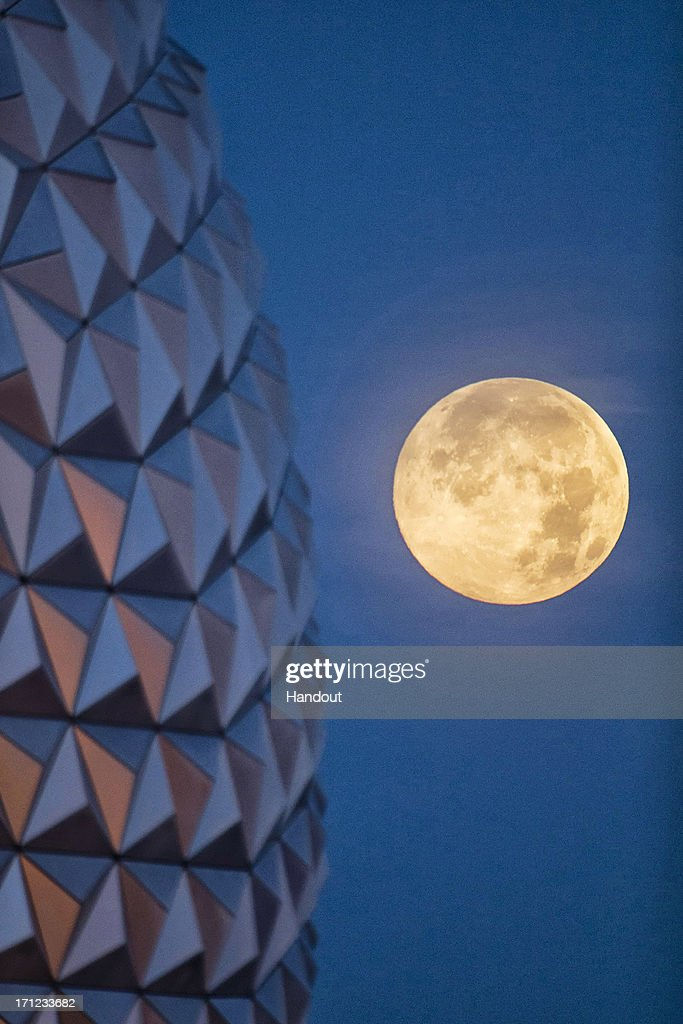 In this handout photo provided by Disney Parks, the 'supermoon' is seen with the Epcot center geodesic sphere in the foreground on June 23, 2013 at Walt Disney World Resort in Lake Buena Vista, Florida. This 'supermoon' is the closest and largest full moon for all of 2013. A 'supermoon' will not occur again until August 10, 2014.