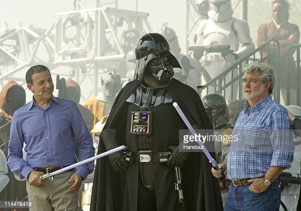 In this handout photo provided by Disney Parks Walt Disney Company President and CEO Bob Iger and 'Star Wars' creator George Lucas attend the grand...