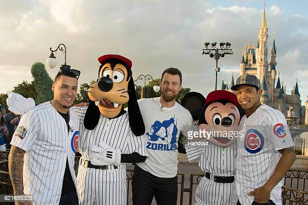 In this handout photo provided by Disney Parks world champions Javier Baez MVP Ben Zobrist and Addison Russell of the Chicago Cubs pose for a...