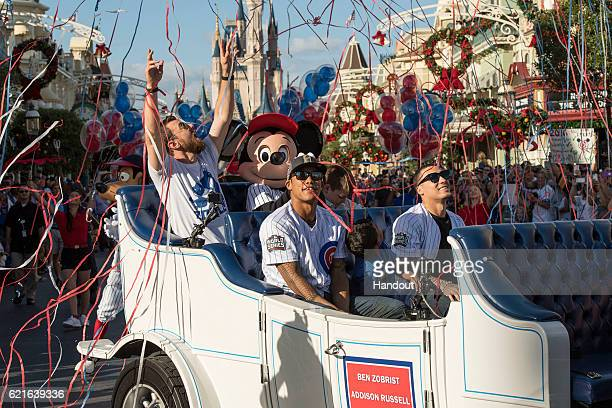 In this handout photo provided by Disney Parks world champions MVP Ben Zobrist Addison Russell and Javier Baez of the Chicago Cubs are joined by...