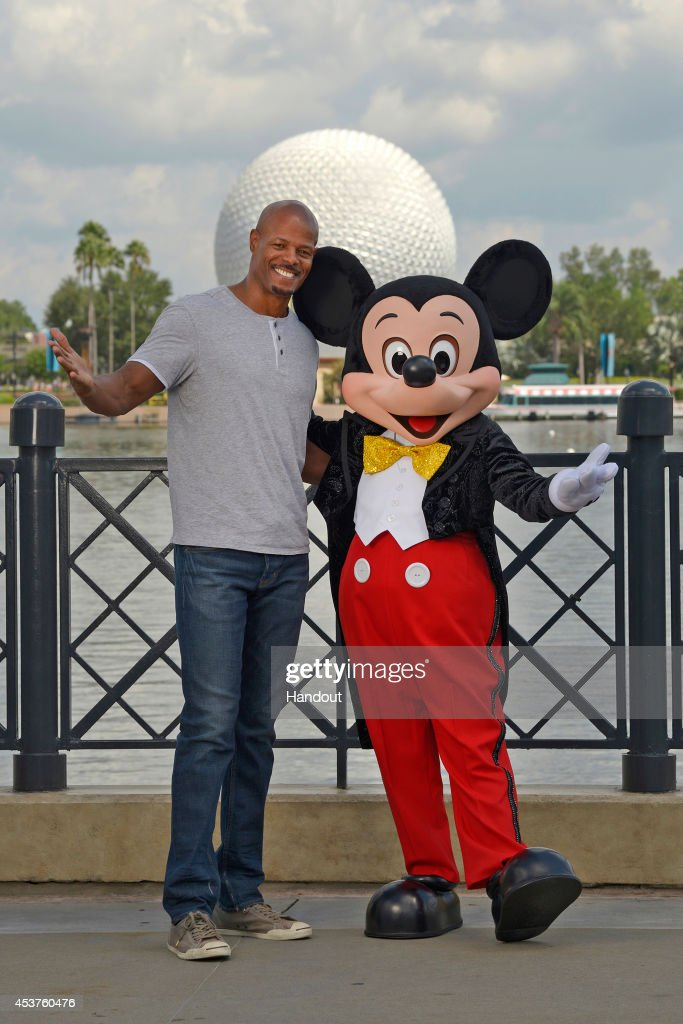 In this handout photo provided by Disney Parks Writer/Director Keenen Ivory Wayans poses with Mickey Mouse in the Epcot theme park at the Walt Disney...