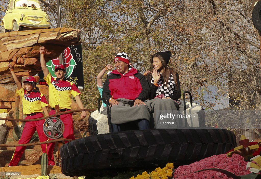 In this handout photo provided by Disney Parks, Zendaya, star of the hit Disney Channel comedy, 'Shake It Up' (right), is joined by Radio Disney personality 'Ernie D' on the Disneyland Resort entry in the 2013 Rose Parade on January 1, 2013 in Pasadena, California. The float brings to life the whimsical magic of Cars Land, a new land in the expanded Disney California Adventure park, before a worldwide television audience on Tuesday. Dubbed 'Destination: Cars Land,' the float showcases the landmarks of Cars Land with a colorful re-creation of the roadside town of Radiator Springs. Shaped like the state of California, the 125-foot long float features flowing water, smoke-puffing baby tractors and 45 animated parts, including replicas of Lightning McQueen and Sally as they relive their fun-spirited road race from the first Disney-Pixar 'Cars' movie.
