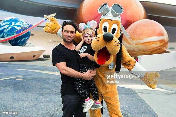 In this handout photo provided by Disney Resorts actor Johnny Galecki and his niece Luci pose with Pluto at the Mission Space attraction at Epcot at...