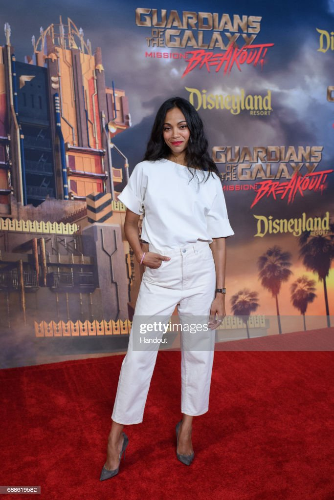 In this handout photo provided by Disney Resorts, actor Zoe Saldana attends the grand opening of Guardians of The Galaxy - Mission: BREAKOUT! attraction on May 25, 2017 at Disneys California Adventure in Disneyland in Anaheim, California.