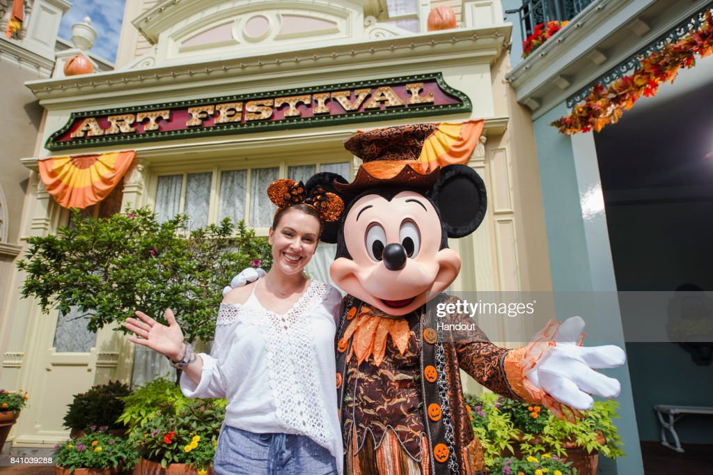 In this handout photo provided by Disney Resorts, actress Alyssa Milano visits the Magic Kingdom Park at Walt Disney World on August 29, 2017 in Lake Buena Vista, Florida.