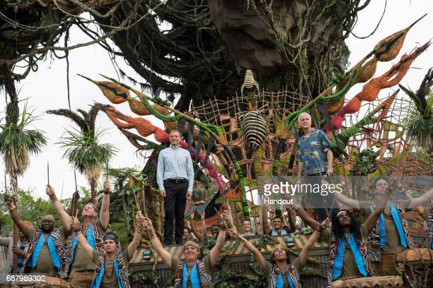 In this handout photo provided by Disney Resorts Chairman and CEO of The Walt Disney Company Bob Iger and producer/director James Cameron attend the...