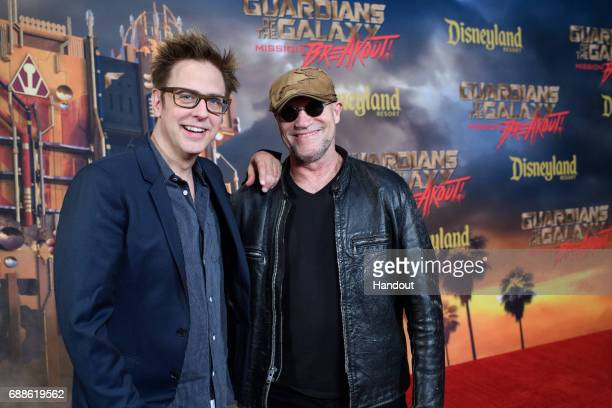 In this handout photo provided by Disney Resorts director James Gunn and actor Michael Rooker attend the grand opening of Guardians of The Galaxy...