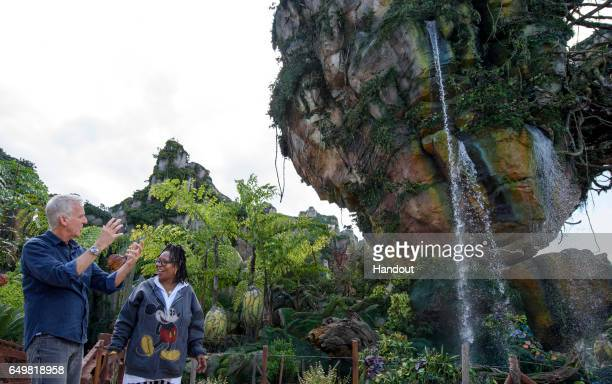 In this handout photo provided by Disney Resorts host Whoopi Goldberg speaks with filmmaker James Cameron during a tour of Pandora The World of...