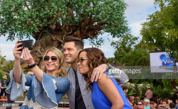 In this handout photo provided by Disney Resorts Singer/Songwriter Andy Grammer poses for a selfie with hosts Sara Haines and Sunny Hostin on ABC's...