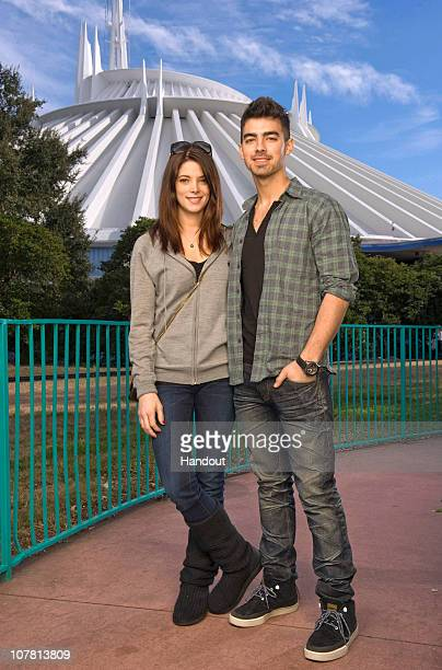 In this handout photo provided by Disney 'Twilight' star Ashley Greene poses with actor/singer Joe Jonas of the poprock trio 'Jonas Brothers' in...