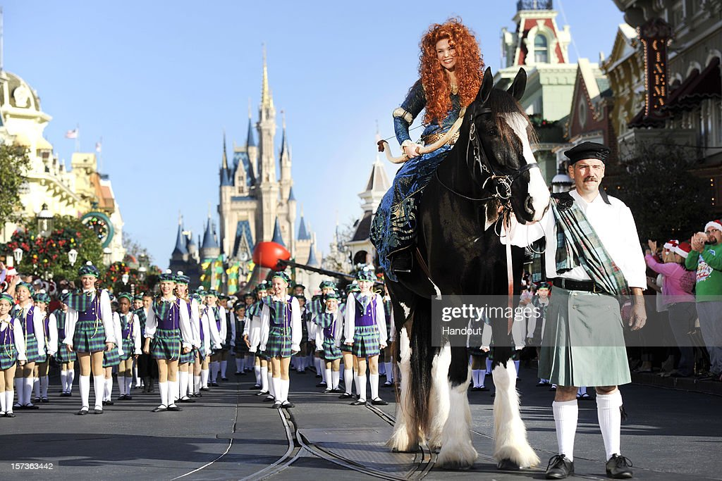 In this handout photo provided by Disney, with hundreds of young performers joining the ensemble, Princess Merida -- from the Disney-Pixar hit film 'Brave' -- sits atop her horse 'Angus' Dec. 1, 2012 during a break in taping the 'Disney Parks Christmas Day Parade' TV special in the Magic Kingdom park at Walt Disney World on December 1,2012 in Lake Buena Vista, Florida. The annual telecast, which airs Dec. 25, 2012 at various times across the country on ABC-TV, features celebrity performances and segments taped at Walt Disney World in Florida and Disneyland Resort in California. Featured performers include Lady Antebellum, Backstreet Boys, Brad Paisley, Phillip Phillips, Colbie Caillat, TobyMac, Yolanda Adams, Ross Lynch, the cast of 'Newsies' and a U.S. Marine Corps Band.