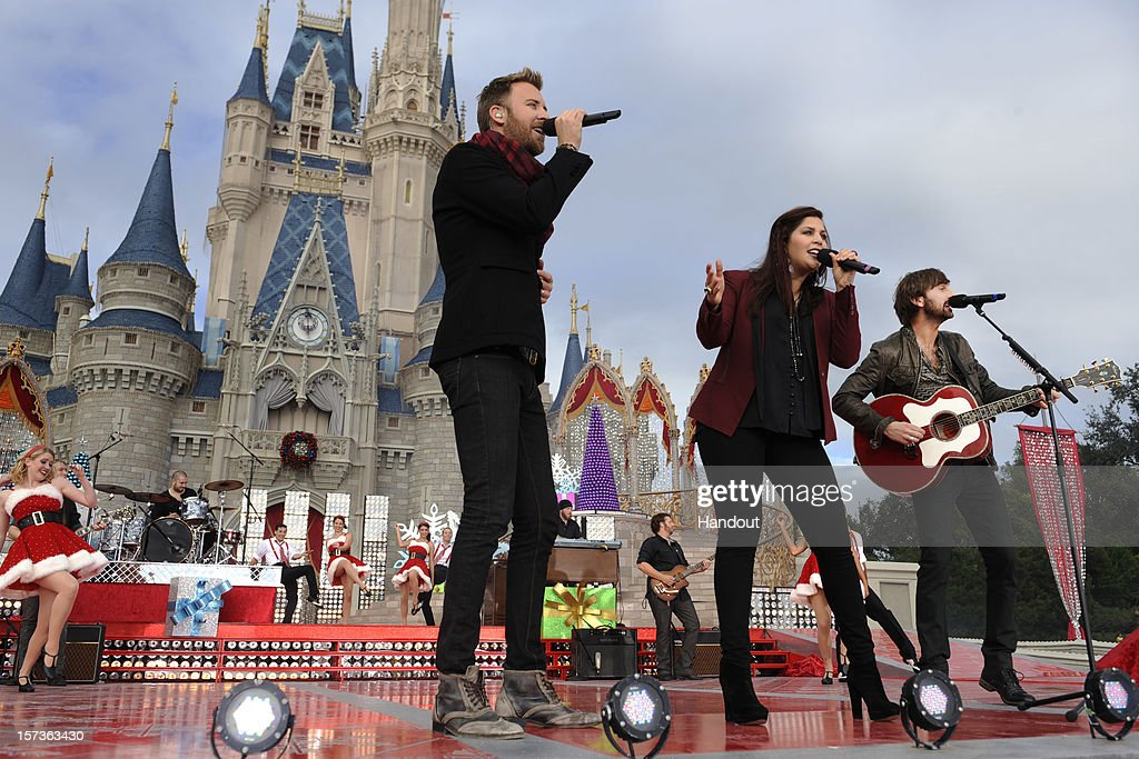 In this handout photo provided by Disney,Grammy Award-winning trio Lady Antebellum tapes a performance for 'Disney Parks Christmas Day Parade' TV special in the Magic Kingdom park at Walt Disney World on December 1,2012 in Lake Buena Vista, Florida. The group headlines the telecast and performs a song from their new holiday album, 'On The Winter's Night.' The annual parade telecast, which airs Dec. 25, 2012 at various times across the country on ABC-TV, features celebrity performances and segments taped at Walt Disney World in Florida and Disneyland Resort in California. Other featured performers include Backstreet Boys, Brad Paisley, Phillip Phillips, Colbie Caillat, TobyMac, Yolanda Adams, Ross Lynch, the cast of 'Newsies' and a U.S. Marine Corps Band.