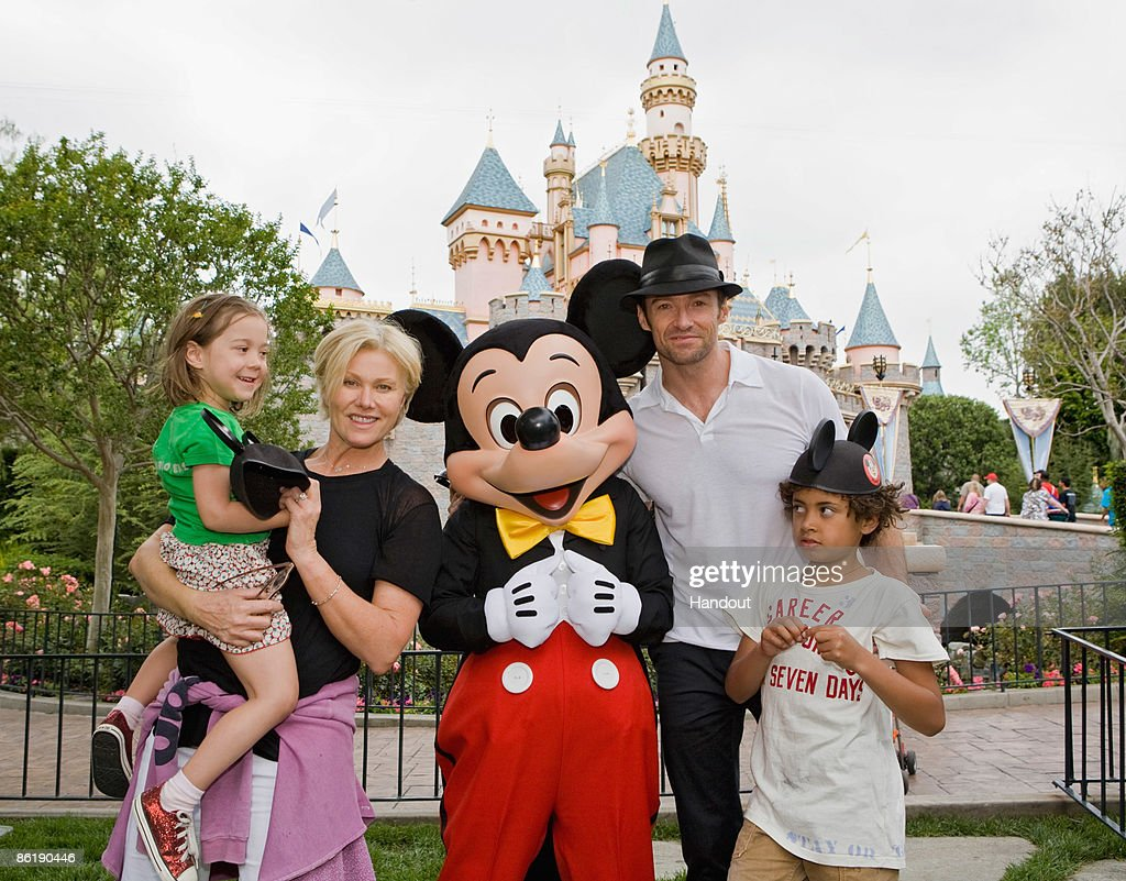 In this handout photo provided by Disneyland, Actor <a gi-track='captionPersonalityLinkClicked' href=/galleries/search?phrase=Hugh+Jackman&family=editorial&specificpeople=202499 ng-click='$event.stopPropagation()'>Hugh Jackman</a>, his wife Deborra Lee Furness, and children Oscar Jackman and Ava Jackman pose with Mickey Mouse outside Sleeping Beauty Castle at Disneyland on April 23, in Anaheim, Calif.
