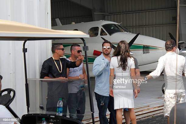 In this handout photo provided by Doug Mendonca Evan Golden and Isis Valverde are seen on the set of a music video at Boca Raton Resort May 31 2014...