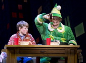 In this handout photo provided by Elf the Musical on Broadway Mitchell Sink as Michael and Jordan Gelber as Buddy perform in 'Elf' on Broadway...