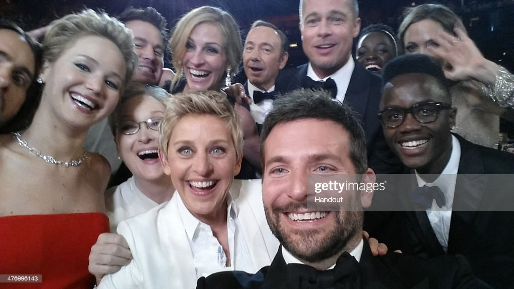 ONLY - In this handout photo provided by Ellen DeGeneres, host Ellen DeGeneres poses for a selfie taken by <a gi-track='captionPersonalityLinkClicked' href=/galleries/search?phrase=Bradley+Cooper&family=editorial&specificpeople=680224 ng-click='$event.stopPropagation()'>Bradley Cooper</a> with (clockwise from L-R) <a gi-track='captionPersonalityLinkClicked' href=/galleries/search?phrase=Jared+Leto&family=editorial&specificpeople=214764 ng-click='$event.stopPropagation()'>Jared Leto</a>, <a gi-track='captionPersonalityLinkClicked' href=/galleries/search?phrase=Jennifer+Lawrence&family=editorial&specificpeople=1596040 ng-click='$event.stopPropagation()'>Jennifer Lawrence</a>, <a gi-track='captionPersonalityLinkClicked' href=/galleries/search?phrase=Channing+Tatum&family=editorial&specificpeople=549548 ng-click='$event.stopPropagation()'>Channing Tatum</a>, <a gi-track='captionPersonalityLinkClicked' href=/galleries/search?phrase=Meryl+Streep&family=editorial&specificpeople=171097 ng-click='$event.stopPropagation()'>Meryl Streep</a>, <a gi-track='captionPersonalityLinkClicked' href=/galleries/search?phrase=Julia+Roberts&family=editorial&specificpeople=202605 ng-click='$event.stopPropagation()'>Julia Roberts</a>, <a gi-track='captionPersonalityLinkClicked' href=/galleries/search?phrase=Kevin+Spacey&family=editorial&specificpeople=202091 ng-click='$event.stopPropagation()'>Kevin Spacey</a>, <a gi-track='captionPersonalityLinkClicked' href=/galleries/search?phrase=Brad+Pitt&family=editorial&specificpeople=201682 ng-click='$event.stopPropagation()'>Brad Pitt</a>, <a gi-track='captionPersonalityLinkClicked' href=/galleries/search?phrase=Lupita+Nyong%27o&family=editorial&specificpeople=10961876 ng-click='$event.stopPropagation()'>Lupita Nyong'o</a>, <a gi-track='captionPersonalityLinkClicked' href=/galleries/search?phrase=Angelina+Jolie&family=editorial&specificpeople=201591 ng-click='$event.stopPropagation()'>Angelina Jolie</a>, Peter Nyong'o Jr. and <a gi-track='captionPersonalityLinkClicked' href=/galleries/search?phrase=Bradley+Cooper&family=editorial&specificpeople=680224 ng-click='$event.stopPropagation()'>Bradley Cooper</a> during the 86th Annual Academy Awards at the Dolby Theatre on March 2, 2014 in Hollywood, California.