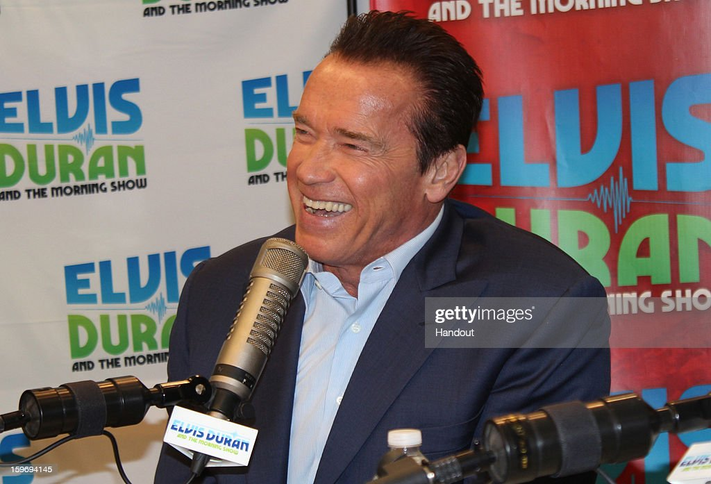 In this handout photo provided by Elvis Duran and the Morning Show, <a gi-track='captionPersonalityLinkClicked' href=/galleries/search?phrase=Arnold+Schwarzenegger&family=editorial&specificpeople=156406 ng-click='$event.stopPropagation()'>Arnold Schwarzenegger</a> and Jaimie Alexander (not pictured) speak with Elvis Duran on 'Elvis Duran and the Morning Show' January 17, 2013 in New York City.