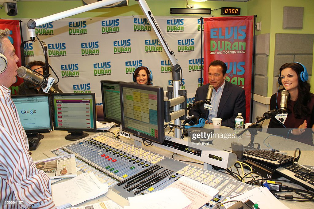 In this handout photo provided by Elvis Duran and the Morning Show, <a gi-track='captionPersonalityLinkClicked' href=/galleries/search?phrase=Arnold+Schwarzenegger&family=editorial&specificpeople=156406 ng-click='$event.stopPropagation()'>Arnold Schwarzenegger</a> and <a gi-track='captionPersonalityLinkClicked' href=/galleries/search?phrase=Jaimie+Alexander&family=editorial&specificpeople=544496 ng-click='$event.stopPropagation()'>Jaimie Alexander</a> speak with Elvis Duran on 'Elvis Duran and the Morning Show' January 17, 2013 in New York City.