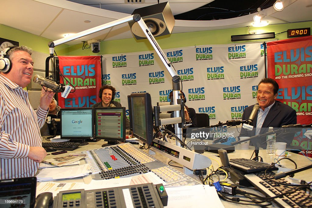 In this handout photo provided by Elvis Duran and the Morning Show, Arnold Schwarzenegger and Jaimie Alexander speak with Elvis Duran on 'Elvis Duran and the Morning Show' January 17, 2013 in New York City.