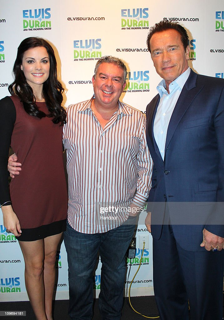 In this handout photo provided by Elvis Duran and the Morning Show, <a gi-track='captionPersonalityLinkClicked' href=/galleries/search?phrase=Jaimie+Alexander&family=editorial&specificpeople=544496 ng-click='$event.stopPropagation()'>Jaimie Alexander</a> (L) and <a gi-track='captionPersonalityLinkClicked' href=/galleries/search?phrase=Arnold+Schwarzenegger&family=editorial&specificpeople=156406 ng-click='$event.stopPropagation()'>Arnold Schwarzenegger</a> (R) speak with Elvis Duran on 'Elvis Duran and the Morning Show' January 17, 2013 in New York City.