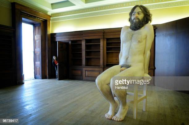 In this handout photo provided by English Heritage Ron Mueck's 'A Wild Man' installation is pictured at Belsay Hall on April 29 2010 in Belsay United...