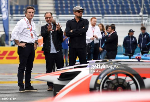 In this handout photo provided by Formula E Leonardo DiCaprio and Fisher Stevens meet with Formula E CEO Alejandro Agag and learned about the racing...