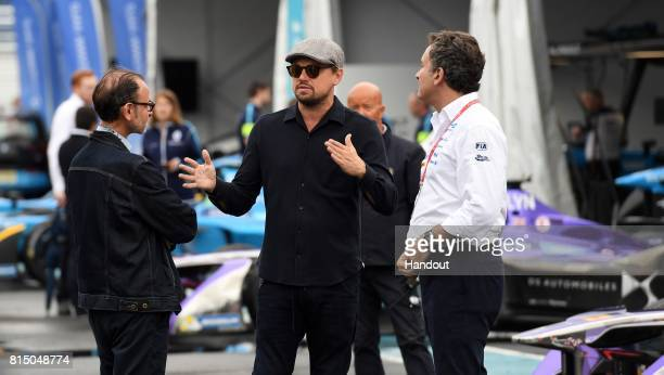 In this handout photo provided by Formula E Leonardo DiCaprio tours the garages on the eve of this weekend's inaugural Formula E New York City ePrix...